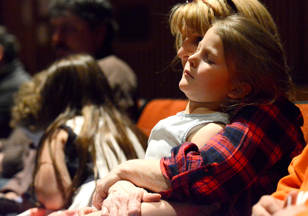 "Justin Sheely | The Sheridan Press<br /> Meg Montgomery holds Gracee Tellez, 5, during the Band Department's ""All That Jazz"" concert night Thursday at the Sheridan High School Sue Henry Auditorium."