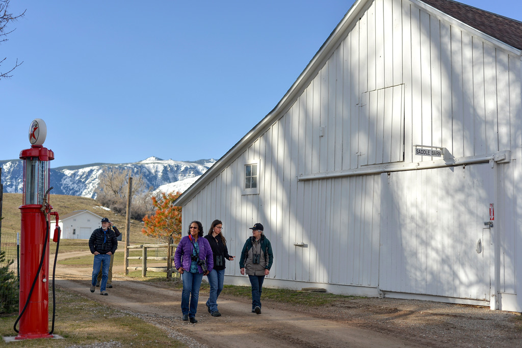Justin Sheely | The Sheridan Press<br /> Bird watchers walk past the barn during the Bighorn Audubon Society Birding at the Brinton Saturday in Big Horn.