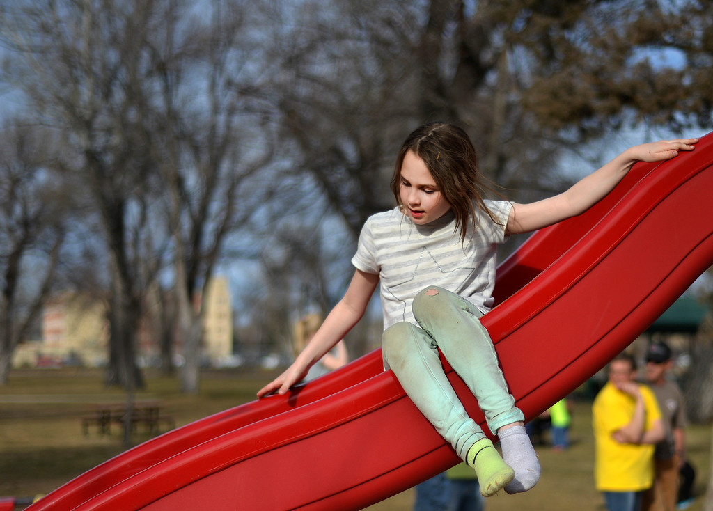 Justin Sheely | The Sheridan Press<br /> Eight-year-old Emmelyn Schasteen slides on the playground Wednesday at Kendrick Park. Sheridan residents enjoyed the extra hour of sunshine and a high temperature of 74.