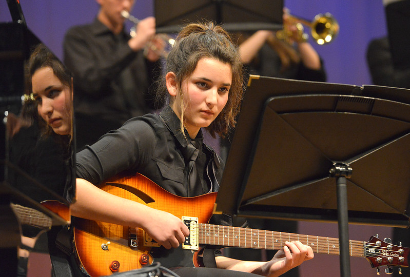 "Justin Sheely | The Sheridan Press<br /> Nandy Crabb plays the electric guitar during the Band Department's ""All That Jazz"" concert night Thursday at the Sheridan High School Sue Henry Auditorium."