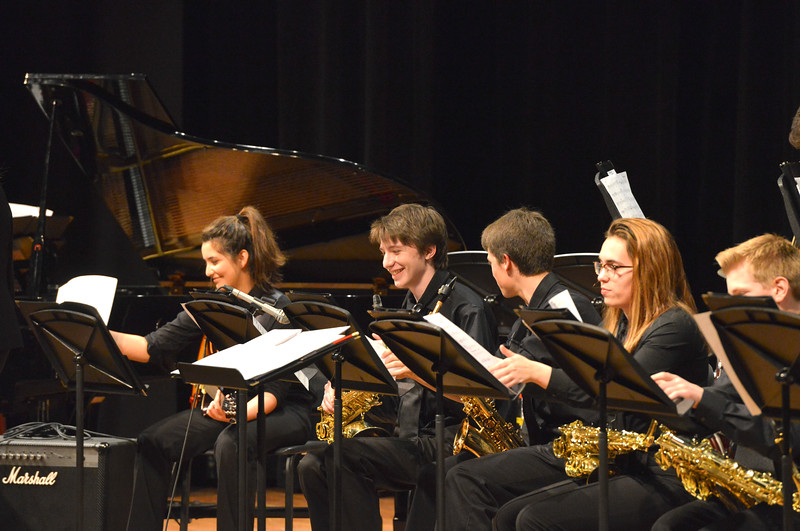 "Justin Sheely | The Sheridan Press<br /> Students flip their music sheets between songs during the Band Department's ""All That Jazz"" concert night Thursday at the Sheridan High School Sue Henry Auditorium."