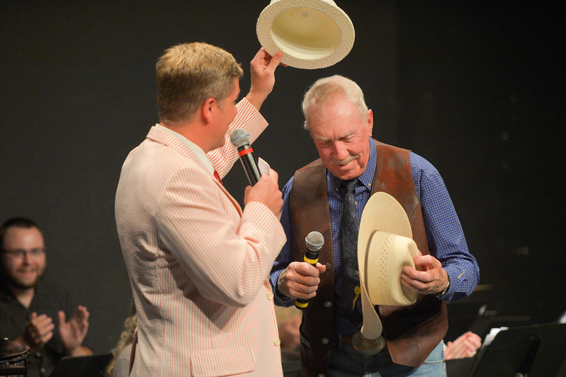 Justin Sheely | The Sheridan Press<br /> Emcee Ryan Koltiska, left, and cowboy poet Jim Hamilton trade hats during the New Vaudevillians variety show Wednesday in the Mars Black Box Theater at the WYO Theater. The next show is August 9 at 7:30 p.m. Tickets are available at the WYO Theater Box office.