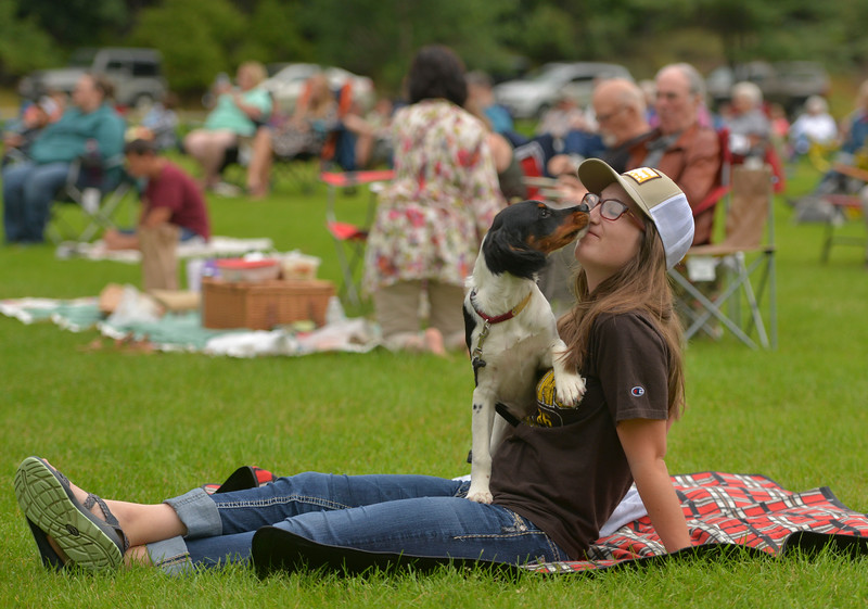 Justin Sheely | The Sheridan Press<br /> Catherine Winnop receives kisses from her 5-month-old French Brittany Oliver during Concerts in the Park Tuesday evening at Kendrick Park.