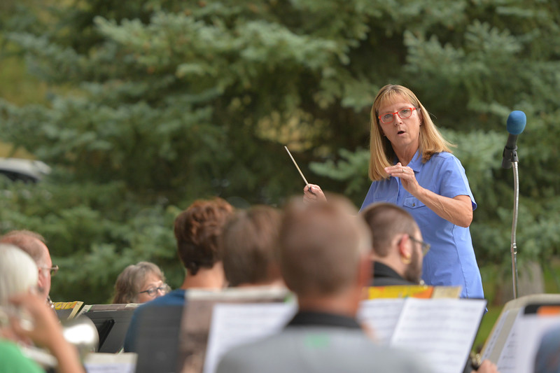 Justin Sheely | The Sheridan Press<br /> Diane Knutson directs the community band during Concerts in the Park Tuesday evening at Kendrick Park.