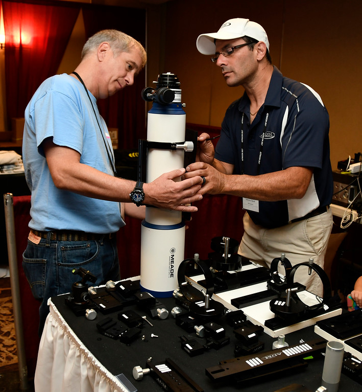 . Aug 18,2017.  Casper WY. (R) Anthony Davoli with ADM accessories helps out  Mark Laurin with a new bracket for his new scope during the 2017 Astrocon convention Friday in Casper  Wy. The town is expecting over 100,000+ eclipse goers to invade the town as it lies in the middle of totality for a full 100% total eclipse for Monday Aug 21st. Photo by Gene Blevins/LA DailyNews/SCNG