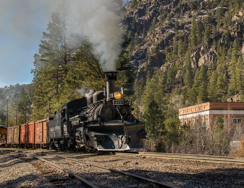 Durango & Silverton train northbound passes the 1905 Tacoma Power Plant.