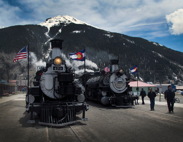 Sections of the first train to Silverton pose on Blair Street in Silverton. May 7, 2016