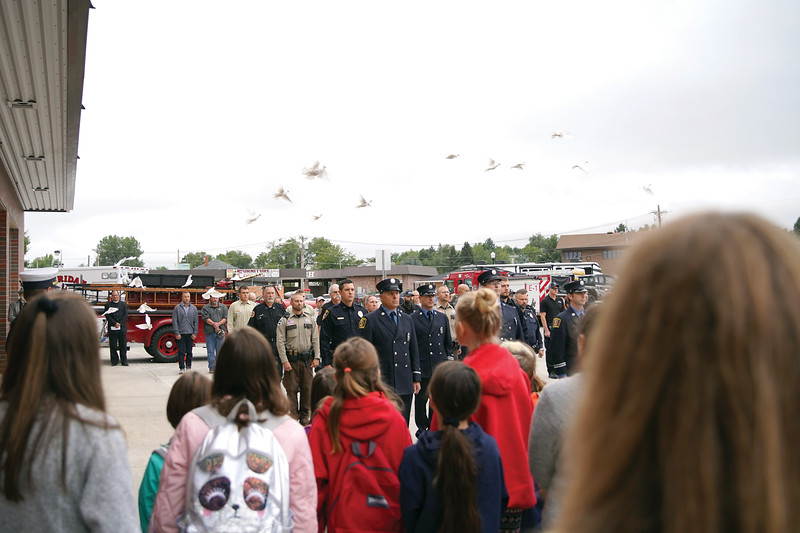 Matthew Gaston | The Sheridan Press<br>Doves fill the sky following a minute of silence.