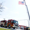 Don Knight | The Herald Bulletin<br /> The body of David Wittkamper is carried past the Pipe Creek Fire Department on Engine 1 during a procession for Wittkamper and Kyle Hibst on Wednesday.