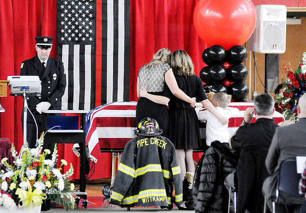 Don Knight | The Herald Bulletin<br /> David Wittkamper's family take a moment at his casket before a funeral for Wittkamper and Kyle Hibst  in Elwood on Wednesday.