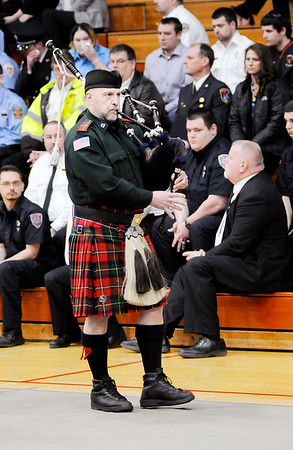 "Don Knight | The Herald Bulletin<br /> A bag piper walks slowly out of the gymnasium while playing ""Amazing Grace"" during the funeral for Kyle Hibst and David Wittkamper in Elwood on Wednesday."