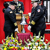 Don Knight | The Herald Bulletin<br /> A firemen's bell is rung for Kyle Hibst and David Wittkamper during their funeral in the Elwood High School Gymnasium on Wednesday.