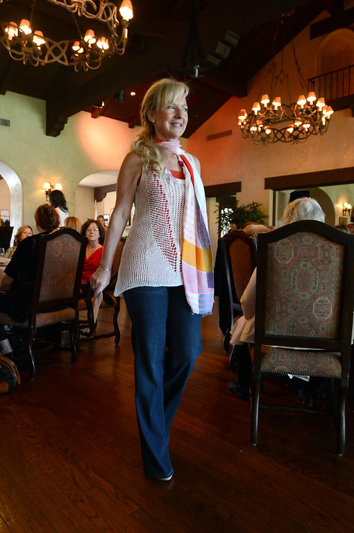 . Cancer survivor Sherri Griner modes during the 4th annual �Love Your Mentors� Fashion Show & Silent Auction will benefit the Women Guiding Women: Cancer Support and Education mentor program at the MemorialCare Breast Center at Long Beach Memorial.  Survivors took to the runway at the Virginia Country Club Thursday afternoon.  Long Beach Calif,  Thursday,  March 6,  2014.   (Photo by Stephen Carr / Daily Breeze)