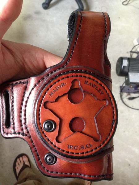 Brown Holster engraving, with black burn marks from our laser.