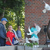 Ashleigh Fox | The Sheridan Press<br> Gwen Turner, left, and Michael Colvin release doves as part of the 9/11 ceremony at Sheridan Fire-Rescue Department Tuesday, Sept. 11, 2018.