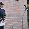 Ashleigh Fox | The Sheridan Press<br> Interim fire chief Gary Harnish steps back from the microphone as lines of first responders retreat into the bays following the 9/11 ceremony at Sheridan Fire-Rescue Department Tuesday, Sept. 11, 2018.