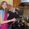 Moranel and Skye cook the meatballs.