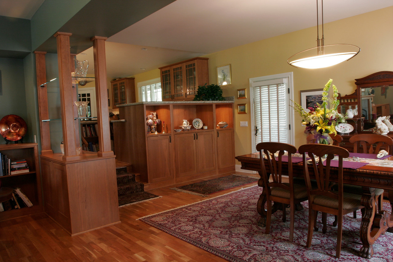 Formerly a garage, now a dining room and den, open to the kitchen.
