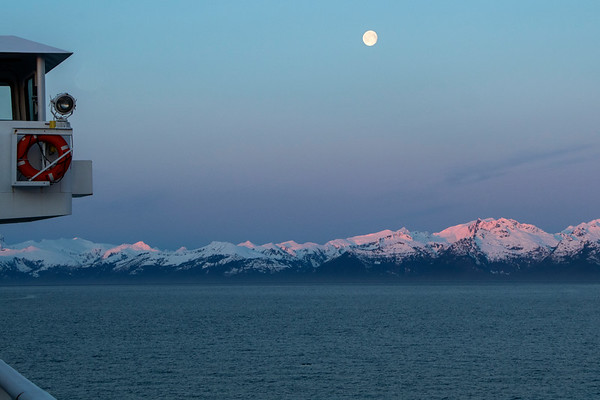 The almost full moon almost setting at sunrise.