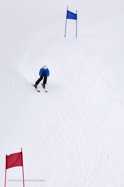 Overhead view from the ski lift of racer on course. 2017 Alta Town Race - GS#8 (Photo by Dave Richards, daverphoto.com)