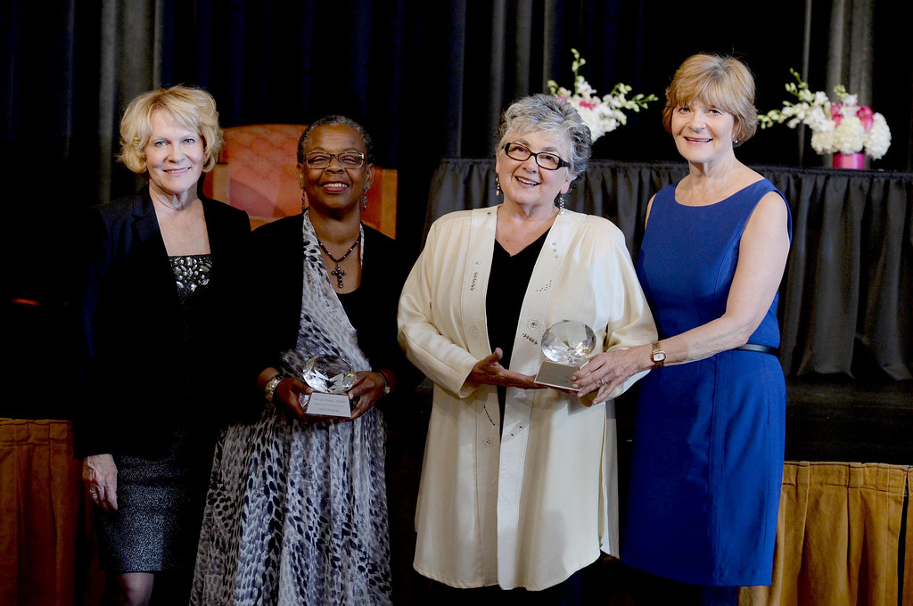 . Education category winner Gina Rushing Maguire, left, volunteer category winner Rev. Dr. Mary Walton, health & wellness category winner Linda Silas, and business/ entrepreneur category winner Diane Donaldson, right, were among the Women being honored at the Press Telegram Amazing Women 2013 Gala in Lakewood, CA. on Wednesday, November 13, 2013. (Photo by Sean Hiller/Press Telegram).