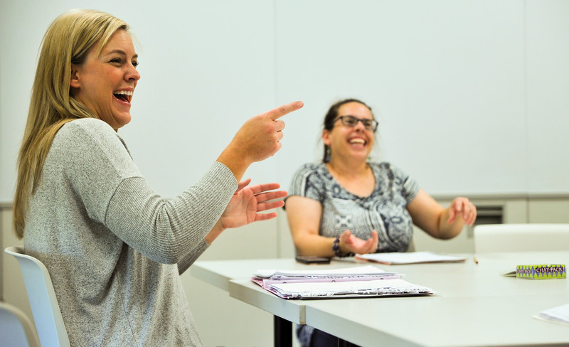 Ryan Patterson | The Sheridan Press<br /> Instructor Amber Towsend, left, and student Jennifer Defoe smile during an American Sign Language 3 class at the Sheridan College Mars Agriculture Center Thursday, Oct. 18, 2018.