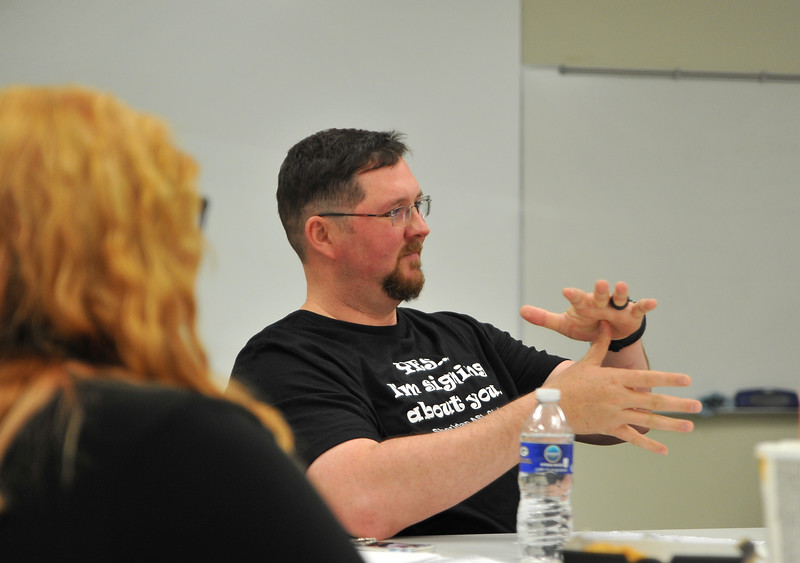 Ryan Patterson | The Sheridan Press<br /> Student Dave Flannery signs during an American Sign Language 3 class at the Sheridan College Mars Agriculture Center Thursday, Oct. 18, 2018. The classes bring together a wide array of people of different ages and backgrounds.