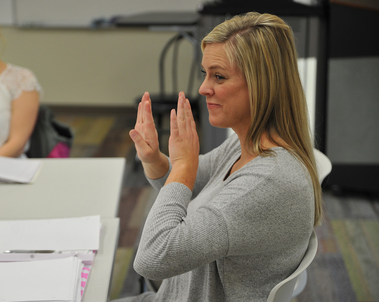Ryan Patterson | The Sheridan Press<br /> Instructor Amber Townsend signs during an American Sign Language 3 class at the Sheridan College Mars Agriculture Center Thursday, Oct. 18, 2018. The classes bring together a wide array of people of different ages and backgrounds.