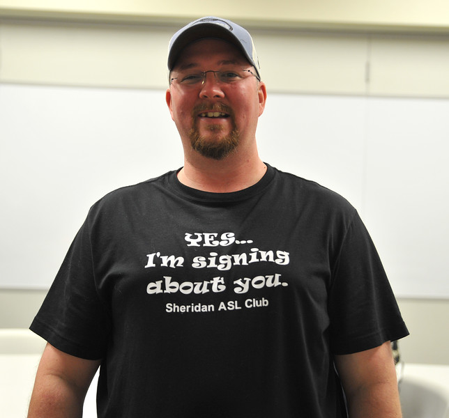 Ryan Patterson | The Sheridan Press<br /> Student Dave Flannery displays his shirt during an American Sign Language 3 class at the Sheridan College Mars Agriculture Center Thursday, Oct. 18, 2018. The classes bring together a wide array of people of different ages and backgrounds.
