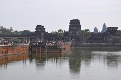 Entrance gate to Angkor Wat.  Moat in foreground.