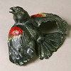 "Red-winged Blackbird.  8""h x 5 1/2""w x 3 1/2""d; brown stoneware. (Sold)."