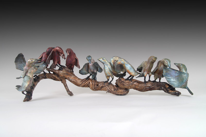 "Starlings Last Supper. Raku, wood, encaustic;  33""L x 10"" H x 12""D.  $1300."