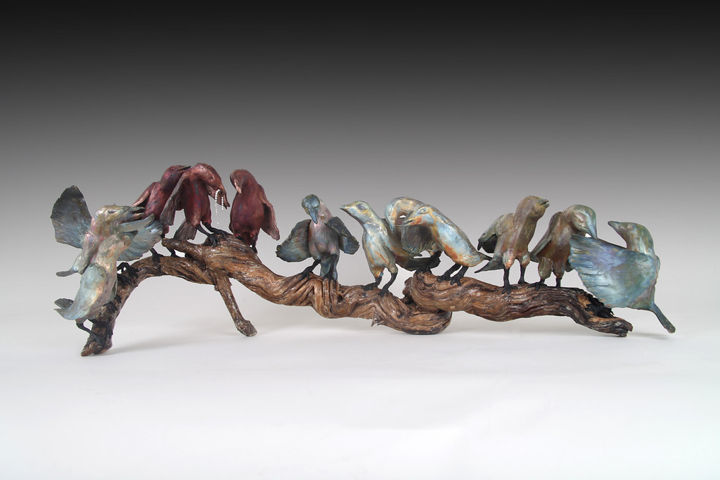 "Starlings Last Supper. Raku, wood, encaustic;  30""L x 10"" H x 8""D.  $1300."