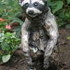 "Raccoon. 18""h x 8""w x16""d; paperclay, raku. (NFS)."