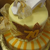 2 tiers round with all buttercream base and real ribbon and porcelain shoe topper