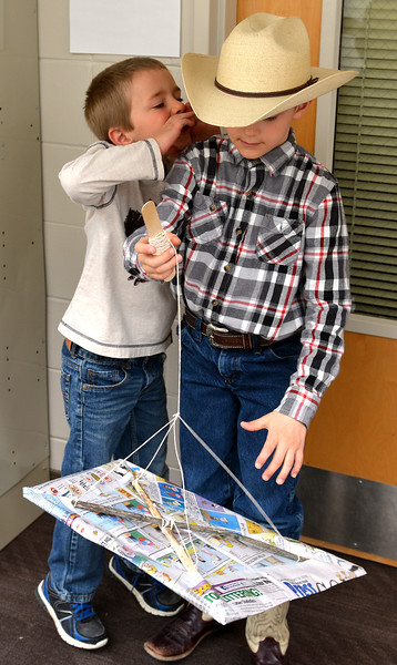 Ryan Patterson | The Sheridan Press<br /> Andrew Langer, left, talks with Parker Lee as he holds his homemade kite during Science Saturday at the Sheridan College Science Center Saturday, April 21, 2018.