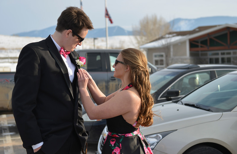 Justin Sheely | The Sheridan Press<br /> Seniors Hugh Patterson, left, and Courtney Good make final touches before heading inside for prom at Tongue River High School Saturday, April 7, 2018.