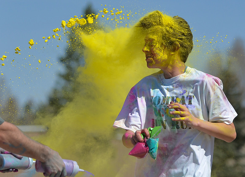 Justin Sheely | The Sheridan Press<br /> Fifteen-year-old Trent Heide gets blasted with color during the annual Combat Color fun run at Sheridan College Saturday, April 28, 2018. The event was organized by and supports the student veterans club.