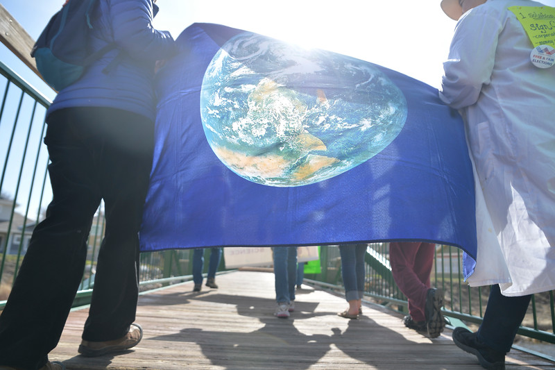 Justin Sheely | The Sheridan Press<br /> Marchers carry a banner during the March for Science at Kendrick Park Saturday, April 14, 2018. The marchers ask for political leaders and policy makers to base their policies on scientific evidence in the public interest – according to the March for Science mission statement on their website.