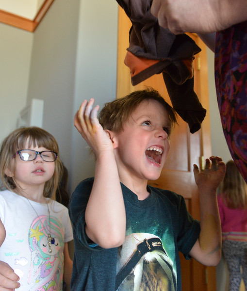 Justin Sheely | The Sheridan Press<br /> Gabriel Cossel reacts as the teacher helps him take off his jacket at Sheridan Absaroka Head Start at the Historic Train Depot Tuesday, April 24, 2018.