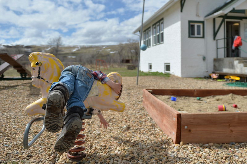 Justin Sheely | The Sheridan Press<br /> First-grader Isaac Hartfeld reaches for a rock that caught his attention at Slack School near Parkman, Wyoming, Wednesday, April 18, 2018. Slack School is a one-room schoolhouse that began more than 100 years ago and serves students in kindergarten through fifth grade in Sheridan County School District 1.