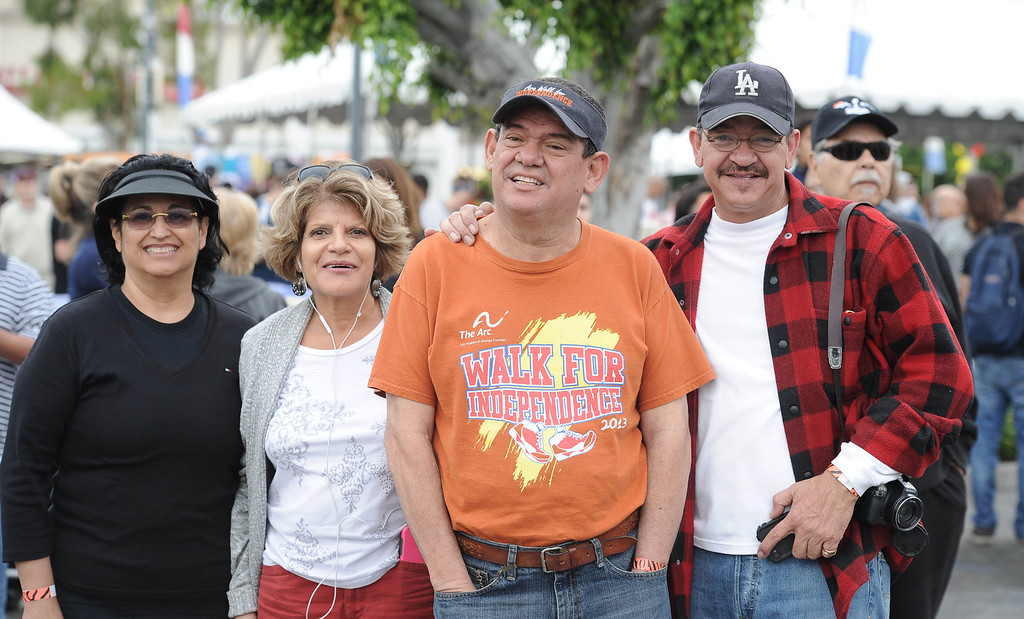 . Jonathan Quintero,center, and his team at the Arc Walk for Independence at the Stonewood Center in Downey, CA. on Saturday March 22, 2014. (Photo by Sean Hiller/ Daily Breeze).