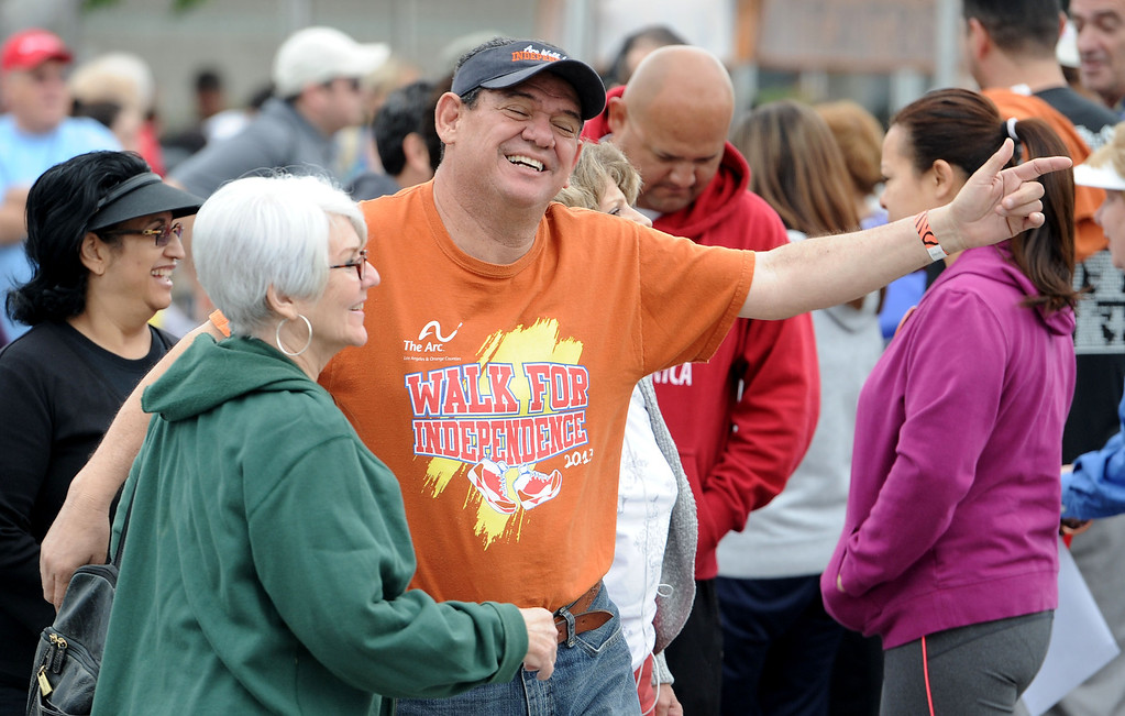 . Jonathan Quintero hugs Irene Ebel at the Arc Walk for Independence at the Stonewood Center in Downey, CA. on Saturday March 22, 2014. (Photo by Sean Hiller/ Daily Breeze).