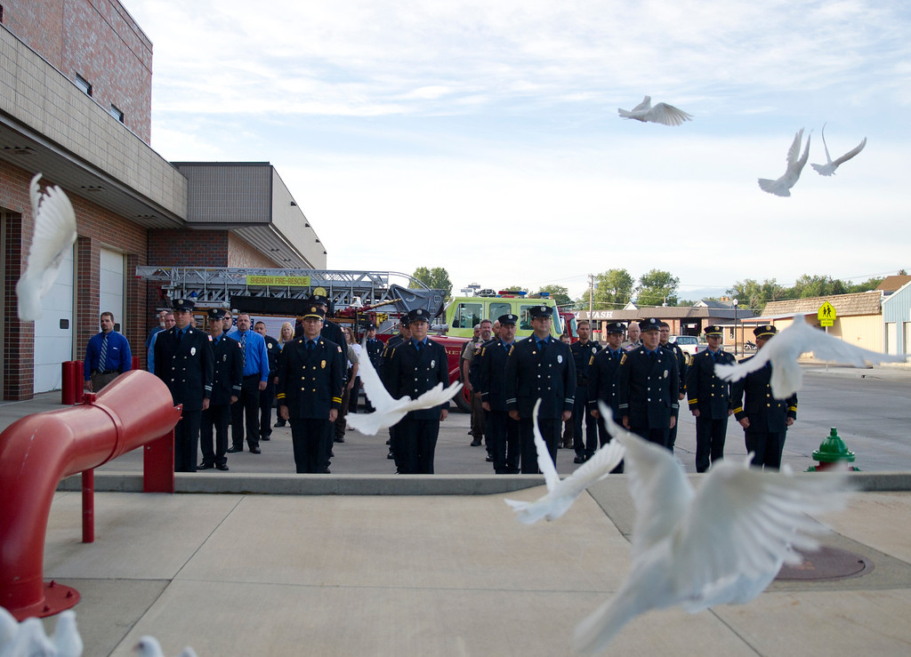 Doves are released after a moment of silence during the 9/11 Remembrance ceremony at Sheridan Fire-Rescue Wednesday, September 11, 2013. (The Sheridan Press/Justin Sheely)