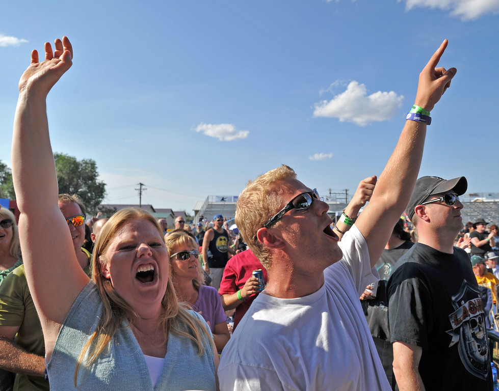Jaydeen, left, and Tyler Huus cheer from the pit as 'FireHouse' performs during the 80's Rock Fest at the Trails End Concert Park Saturday, Aug. 24, 2013. (The Sheridan Press/Justin Sheely)