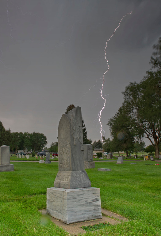 Lightning strikes the ground near the Sheridan Municipal Cemetery Tuesday evening.