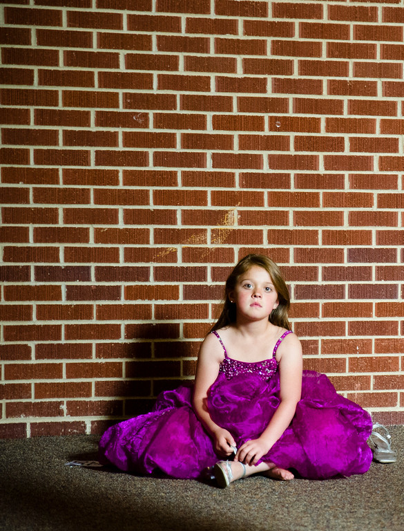 Kayleigh Web, from Mountain View, Wyo., hangs out in the lobby of the Early Auditorium Saturday during the Little Miss Wyoming pageant. June 8, 2013. (The Sheridan Press/Justin Sheely)