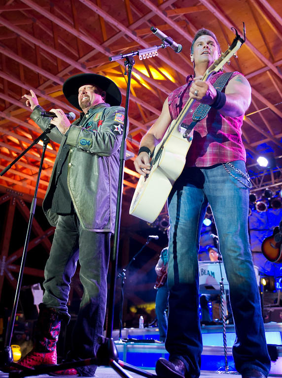 Eddie Montgomery, left, and Troy Gentry perform onstage during the Montgomery Gentry Concert Friday Night at the Trails End Concert Park. Aug. 2, 2013. (Justin Sheely/The Sheridan Press)