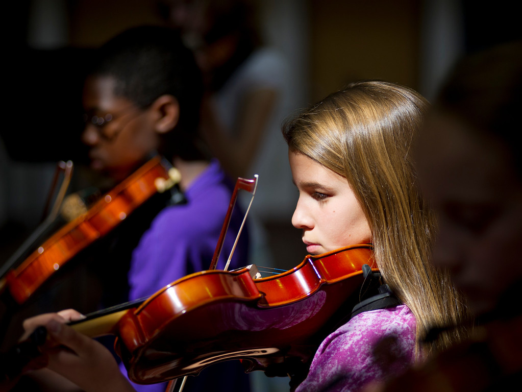Maria Hall, 12, practices on her Violin with the Intermediate group for the Summer Strings Program Wednesday morning at the Sheridan High School. (The Sheridan Press/Justin Sheely)