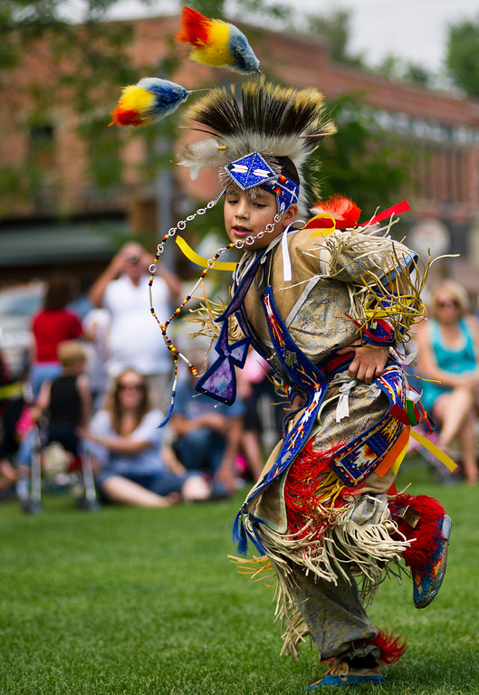 Tyler Small, 9, of the Northern Cheyenne in Ashland, Mont., performs a Grass Dance during the Longmire Days celebration Saturday in Crazy Woman Square in Buffalo. (The Sheridan Press/Justin Sheely)